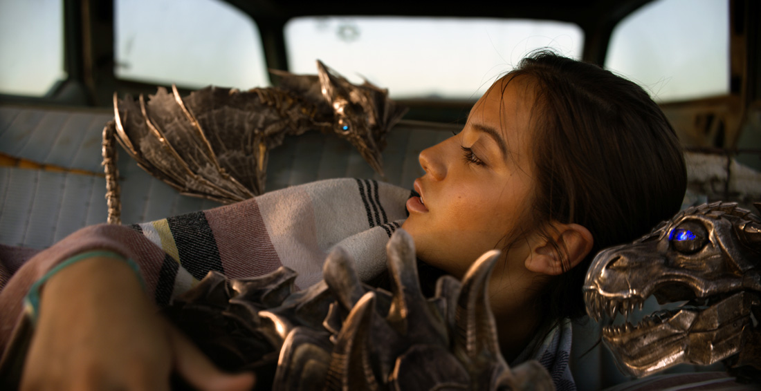 Left to right: Mini-Strafe, Mini-Slug, Isabela Moner as Izabella and Mini-Grimlock in TRANSFORMERS: THE LAST KNIGHT, from Paramount Pictures.
